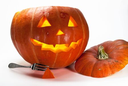 Halloween Pumpkin, inside lit by candle, creepy looking, white background Stock Photo - 5566845