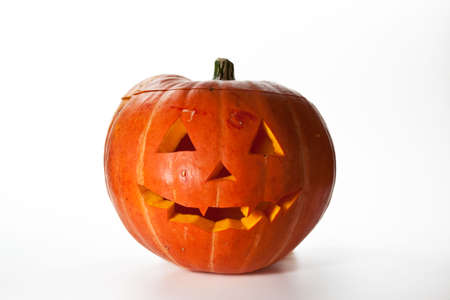Halloween Pumpkin, inside lit by candle, creepy looking, white background photo