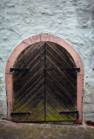 Old wooden Door on medieval House in Dilsberg photo