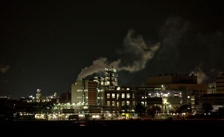 Chemical Factory At Night, with smoke and steam photo