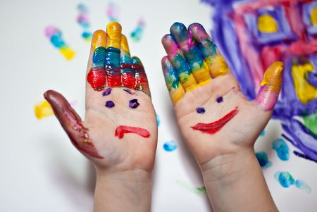 Little Children Hands doing Fingerpainting with various colors photo