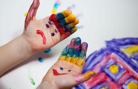 fingerpaint: Little Children Hands doing Fingerpainting with various colors