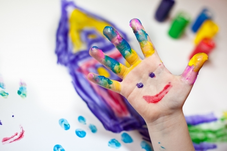 Little Children Hands doing Fingerpainting with various colors Stock Photo - 5971968