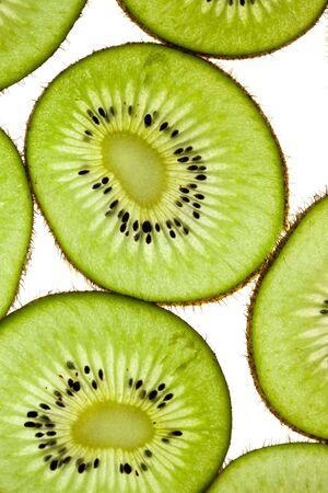 actinidia deliciosa: Sliced Kiwifruit isolated on white studio shot