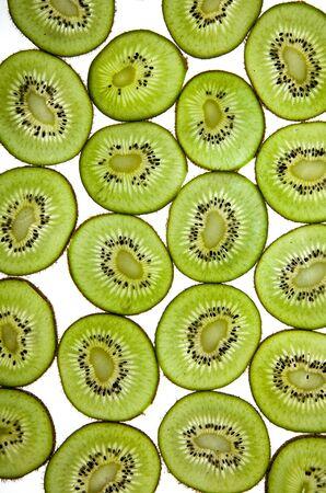 Sliced Kiwifruit isolated on white studio shot photo