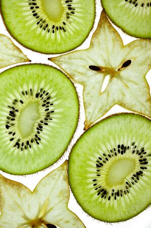 Sliced Kiwifruit and Starfruit isolated on white studio shot photo