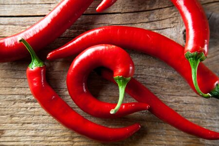 spicy chilli: Fresh Red Chili Pepper on wooden board