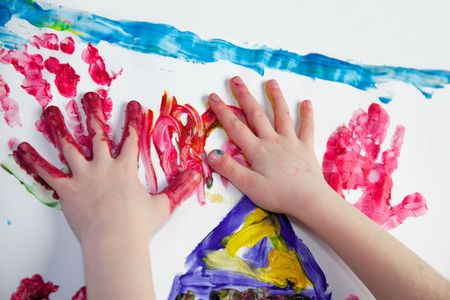 Little Children Hands doing Fingerpainting with vivid colors photo