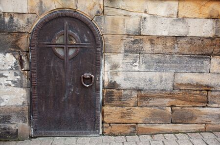 Sturdy Old Door made of Metal on historic building photo
