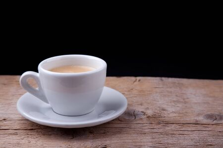 steaming: Hot Coffee in white cappuchino cup on wooden table