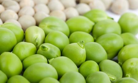 Fresh green peas and dried peas isolated on white studio shot photo