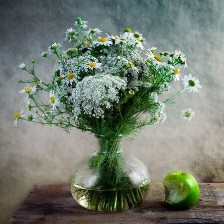 Still Life with Apple and flowers in vase photo