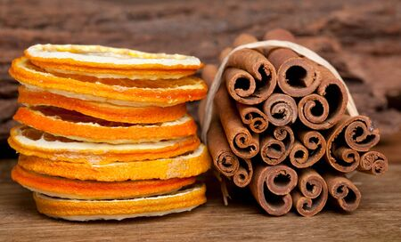 Slices of dried Orange with cinnamon sticks photo
