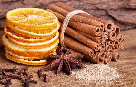 Slices of dried Orange with sugar cinnamon clove and anise Stock Photo