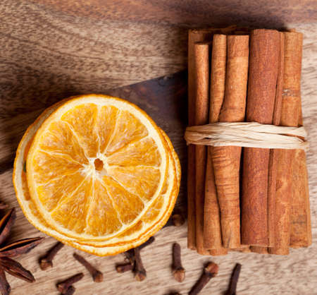 Slices of dried Orange with cinnamon clove and anise Stock Photo - 8212971