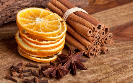 Slices of dried Orange with cinnamon clove and anise photo