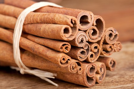 Cinnamon spice Sticks on wooden board close up photo