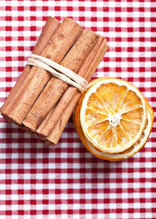Dried Orange and Cinnamon Sticks on chequered cloth Stock Photo - 8285204