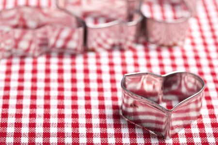 Cookie Cutters for christmas bakery on chequered cloth photo