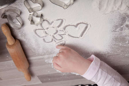 Making homemade christmas cookies in various shapes photo