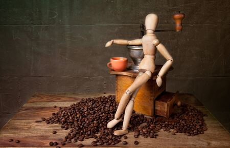 Still Life with Coffee grinder and jointed doll working the mill Stock Photo - 8415002