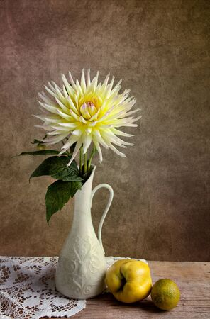 stillife: Dahlia Flowers in Vase with Quince and Lime fruit