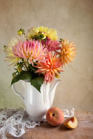Dahlia Flowers in Vase with Peach fruit Stock Photo - 8507835