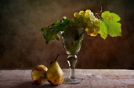 Still life with pears and grapes in goblet Stock Photo - 8584341