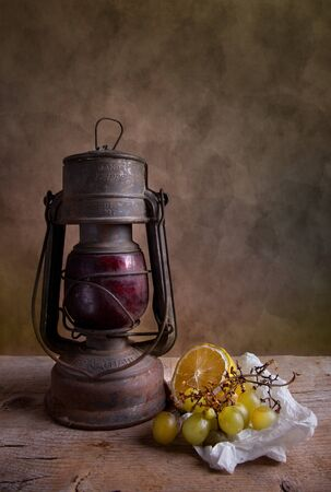 Still life with lantern and grapes with lemon Stock Photo - 8584338