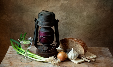 Still life with lamp and various organic vegetables with bread