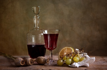 stilllife: Still life with red wine and grapes with lemon Stock Photo