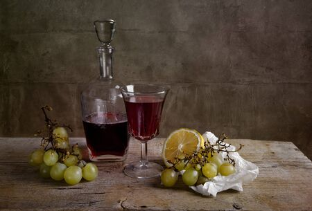 Still life with red wine and grapes with lemon Stock Photo - 8584345