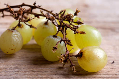 fresh and ripe white grapes on wooden board Stock Photo - 8584347