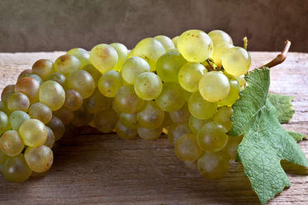 fresh and ripe white grapes on wooden board Stock Photo - 8584352