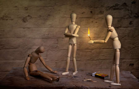 companion: homeless dolls warming hand on fire with sick companion
