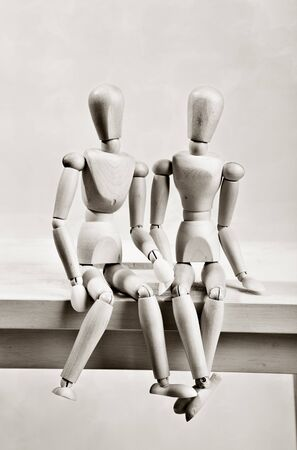 jointed: Two jointed dools male and female sitting together happy Stock Photo