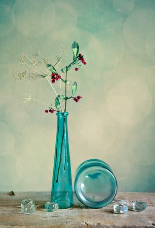 antique vase: Still Life with glass vase and berries
