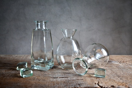 grunge bottle: Still Life with differently shaped glass bottles Stock Photo