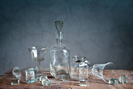 antique vase: Still Life with differently shaped glass bottles Stock Photo