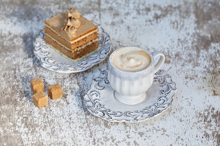 mocca: Coffee and mocca Cake in old white cup and dish