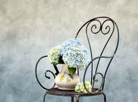 flowers in vase: Still Life photo with Hortensia Flowers on rusty Chair