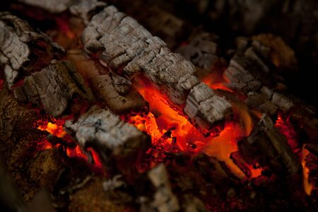 smoldering: Glowing embers from burned down fire in fireplace Stock Photo