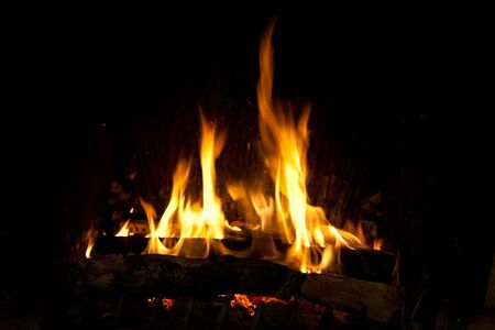 Burning and glowing pieces of wood in Fireplace Stock Photo - 10543412