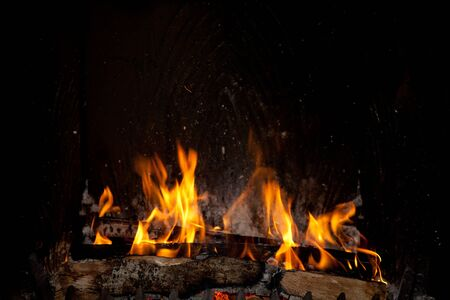 smolder: Burning and glowing pieces of wood in Fireplace Stock Photo
