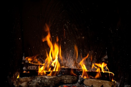 Burning and glowing pieces of wood in Fireplace Archivio Fotografico