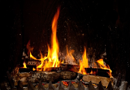 wood and fire: Burning and glowing pieces of wood in Fireplace Stock Photo