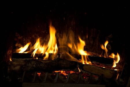 cinders: Burning and glowing pieces of wood in Fireplace Stock Photo
