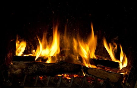 woodpile: Burning and glowing pieces of wood in Fireplace Stock Photo