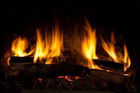 Burning and glowing pieces of wood in Fireplace photo