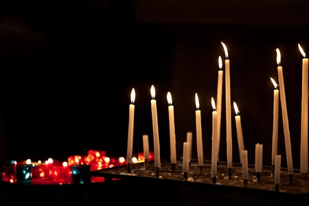 Many burning prayer candles in catholic church Stock Photo - 10630643